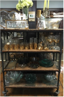 Assortment of china on various shelves.
